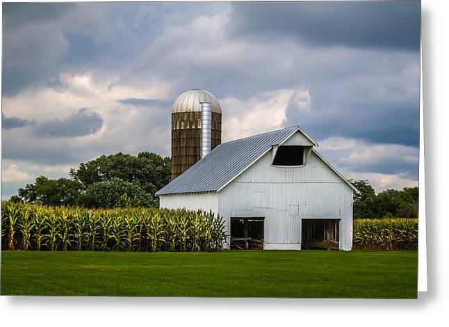 White Barn And Silo With Storm Clouds Greeting Card