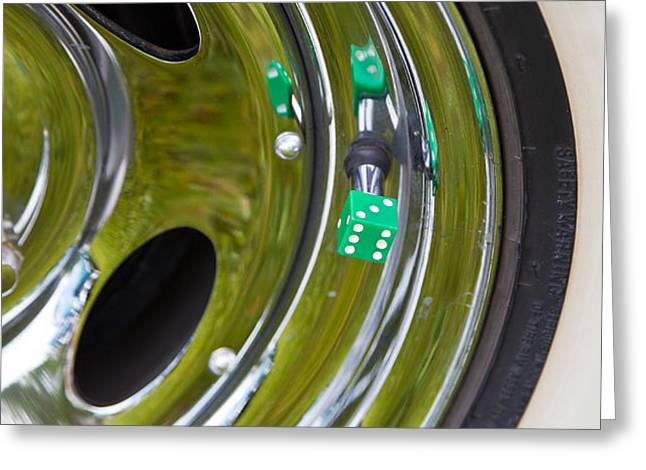 Greeting Card featuring the photograph White Wall Tyre Chrome Rim And Dice by Mick Flynn