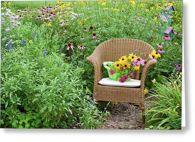 Wicker Chair With Basket And Birdhouse Greeting Card by Panoramic Images