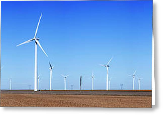 Wind Turbines In A Field Against Blue Greeting Card by Panoramic Images
