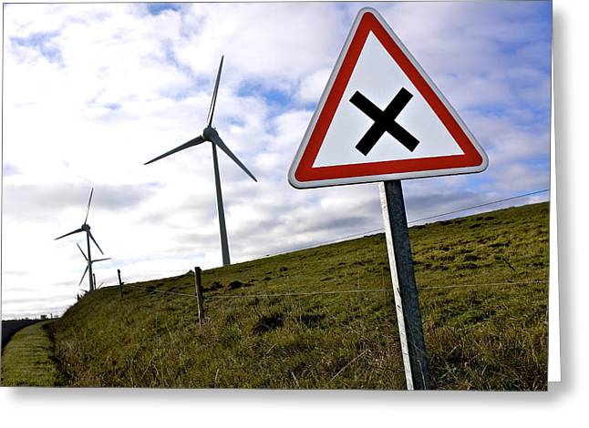 Wind Turbines On The Edge Of A Field With A Road Sign In Foreground. Greeting Card by Bernard Jaubert