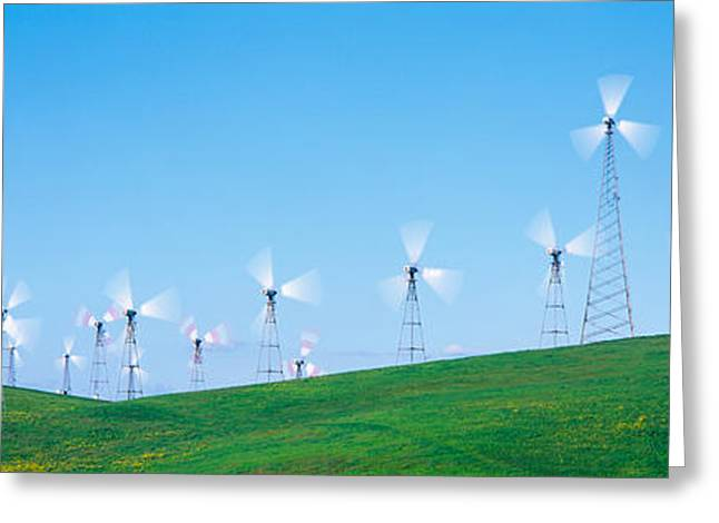 Wind Turbines Spinning On Hills Greeting Card