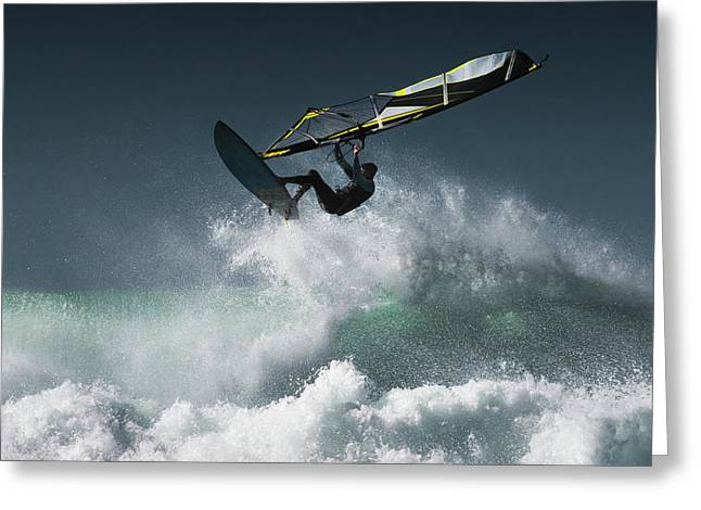 Windsurfer In The Air Above Splashing Greeting Card by Ben Welsh