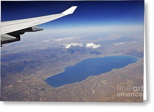 Wing Of Flying Airplane Over Lake And Mountains Greeting Card by Sami Sarkis