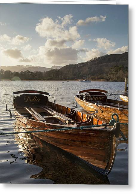 Woden Boats Tied At The Water S Edge Greeting Card by John Short