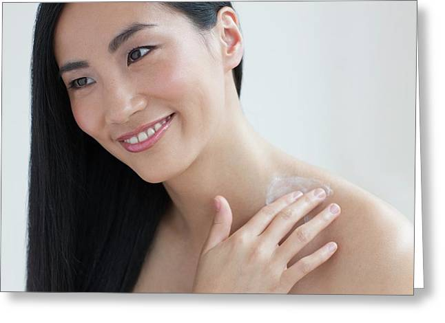 Woman Applying Body Cream Greeting Card