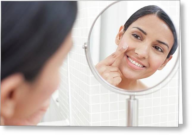 Woman Applying Face Cream Greeting Card