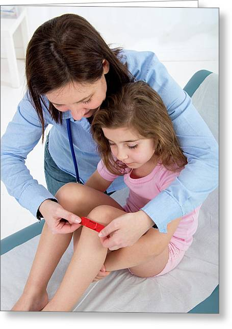 Woman Applying Plaster To Girl's Knee Greeting Card