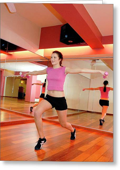 Woman Exercising In A Gym Greeting Card by Aj Photo/science Photo Library
