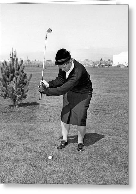 Woman Golfer Ready To Swing Greeting Card by Underwood Archives