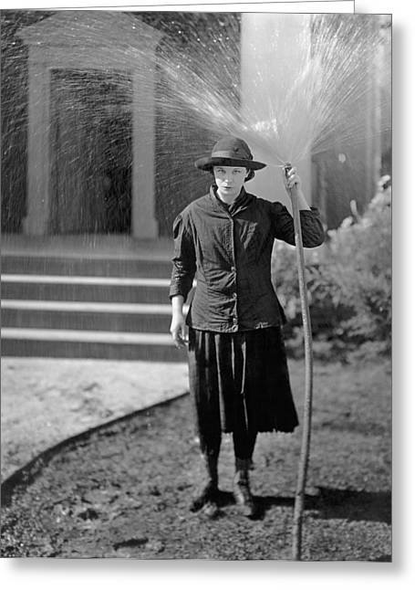 Woman Hoses Herself Greeting Card by Underwood Archives