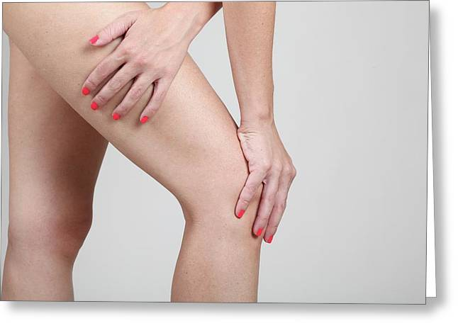 Woman Massages Her Painful Knee Greeting Card