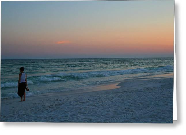 Woman On Beach At Dusk Greeting Card by Karen Adams