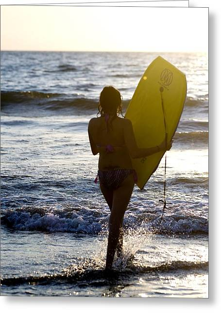 Woman On Beach Carrying Bodyboard Greeting Card by Keith Levit