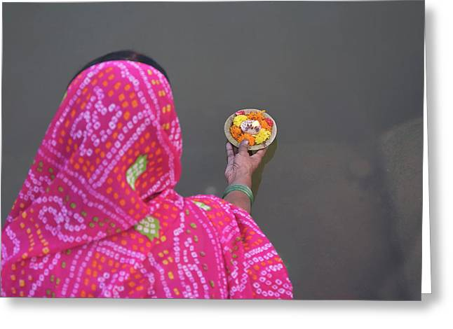 Woman Putting Flower Lamp Onto Greeting Card