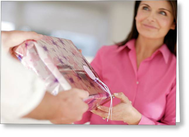 Woman Recieving A Gift Greeting Card