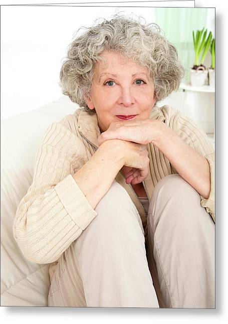 Woman Resting With Her Chin On Hands Greeting Card