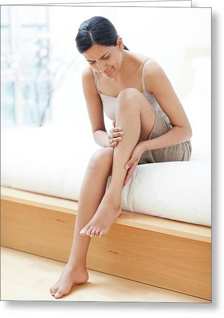 Woman Rubbing Her Leg Greeting Card