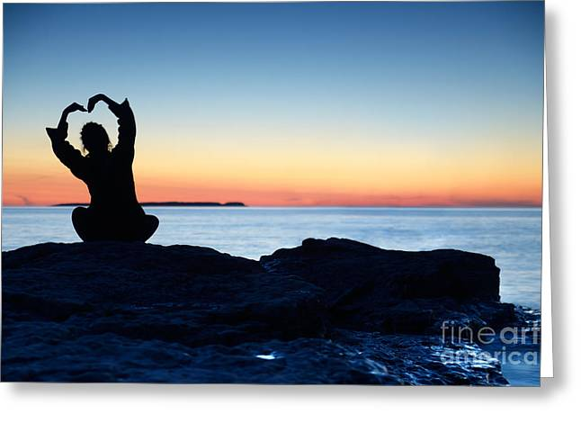 Woman Silhouette Alone On Shore With Hand In Shape Of Flower Greeting Card by Oleksiy Maksymenko