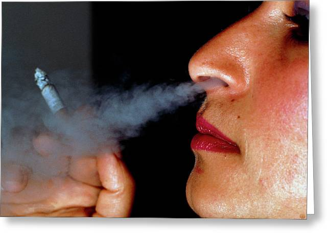 Woman Smoking A Cigarette Greeting Card by Harvey Pincis/science Photo Library