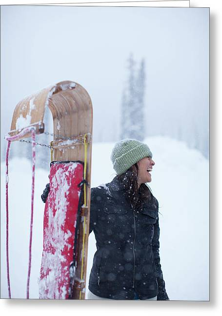 Woman Standing With Toboggan Sled Greeting Card
