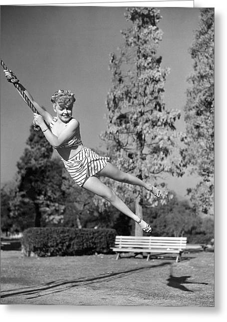 Woman Swinging On A Rope Greeting Card by Underwood Archives