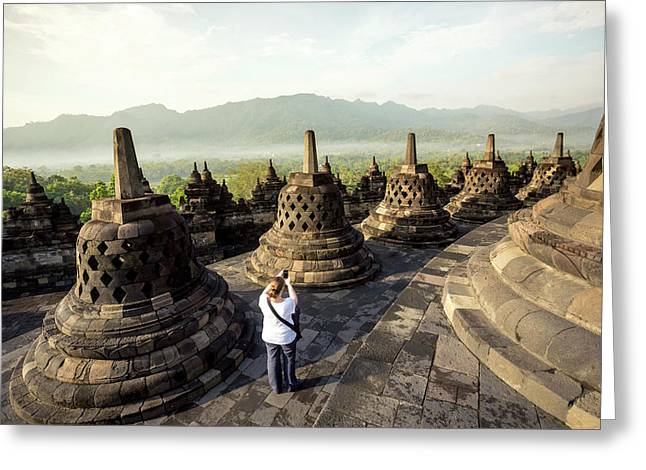 Woman Taking Pictures Of Stupas Greeting Card