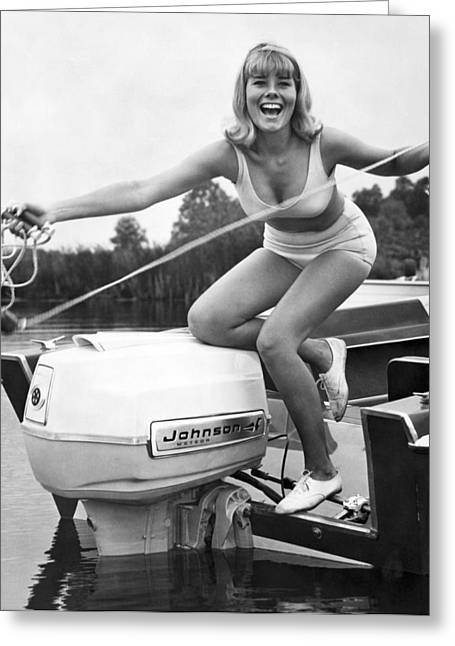 Woman Throwing A Boat Line Greeting Card by Underwood Archives