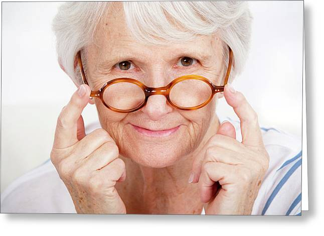 Woman Touching Glasses Greeting Card
