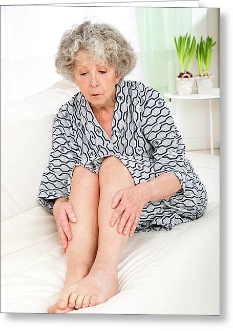 Woman Touching Her Legs Greeting Card