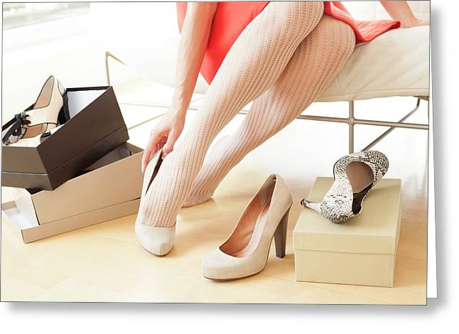 Woman Trying On Shoes Greeting Card by Ian Hooton