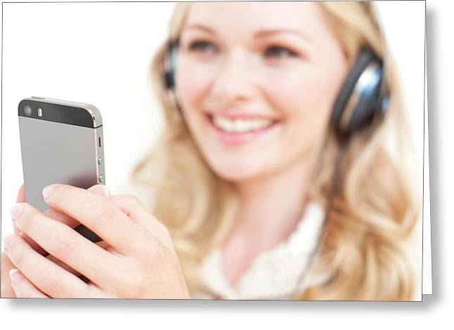 Woman Wearing Headphones Holding Smartpho Greeting Card