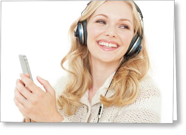 Woman Wearing Headphones With Smartphone Greeting Card by Ian Hooton
