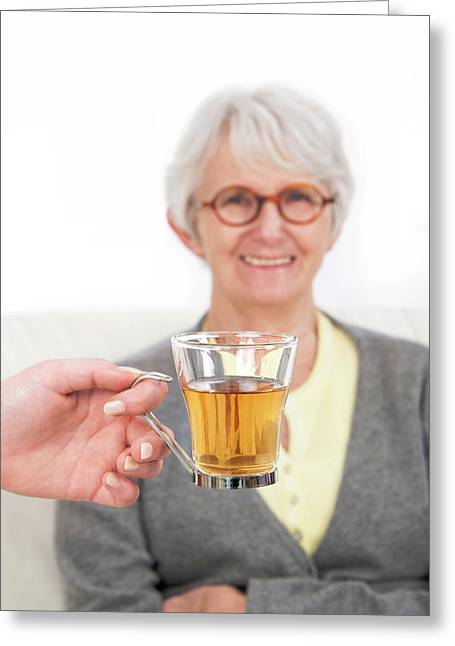 Woman With A Hand Holding Glass Of Tea Greeting Card by Lea Paterson