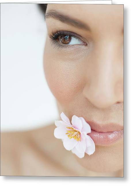 Woman With Flower Greeting Card by Ian Hooton/science Photo Library