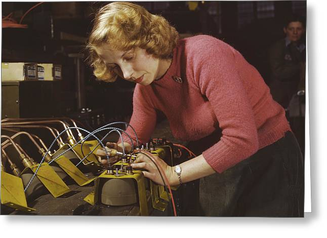 Woman Working On Black-out Lamps Greeting Card by Stocktrek Images