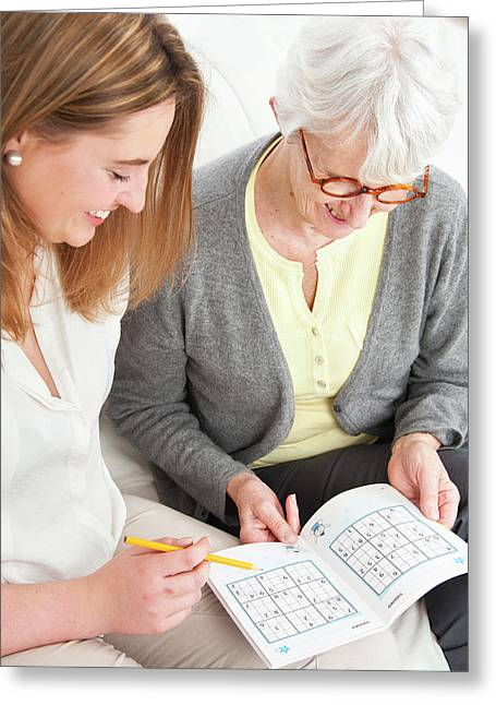 Women Doing Puzzle Greeting Card by Lea Paterson