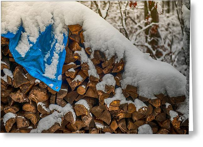 Wood Pile In The Snow Greeting Card by Paul Freidlund