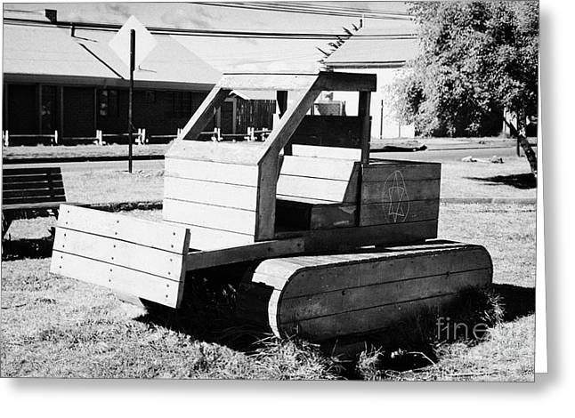 wooden bulldozer in a childrens play area with grafitti star of david scraped onto the side Punta Arenas Chile Greeting Card by Joe Fox