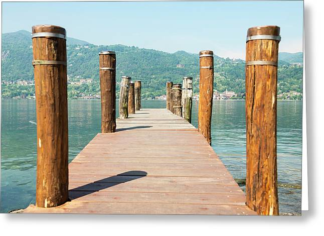 Wooden Dock And Posts On Lake Orta Greeting Card
