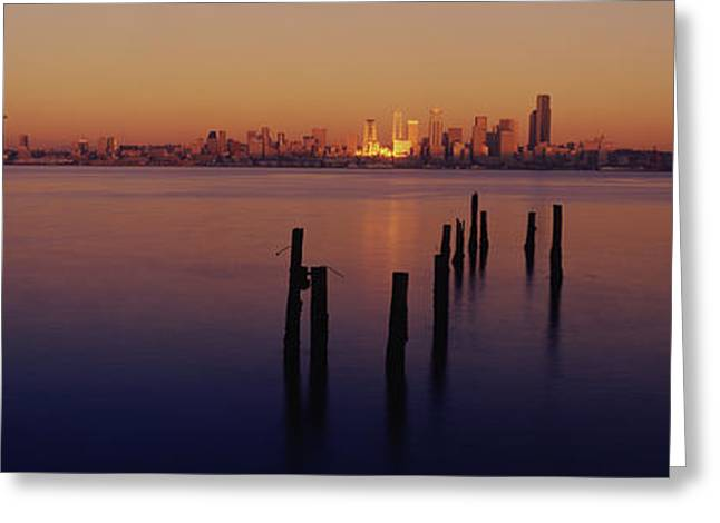 Wooden Posts In The Sea At Dusk Greeting Card by Panoramic Images