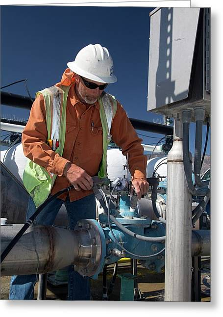 Worker Inspecting Water Pumps Greeting Card