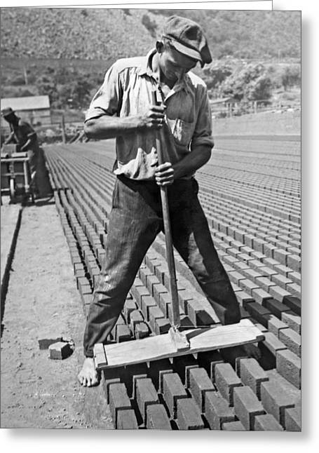 Worker Stamping Out Bricks Greeting Card by Underwood Archives