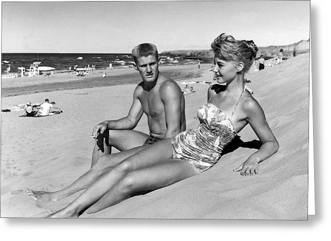 Young Adults On A Beach Greeting Card by Underwood Archives