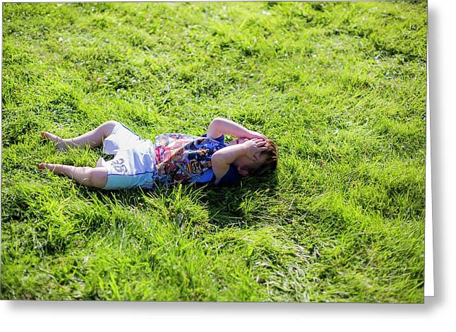 Young Boy Lying On Grass Greeting Card