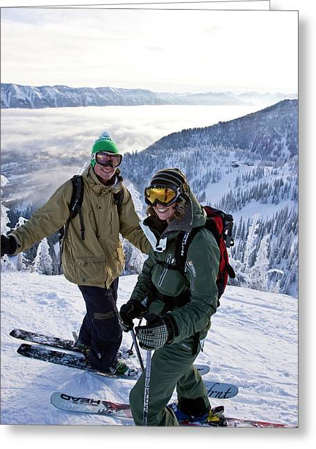 Young Couple Smile At Top Of Ski Run Greeting Card