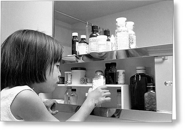 Young Girl In Medicine Cabinet Greeting Card