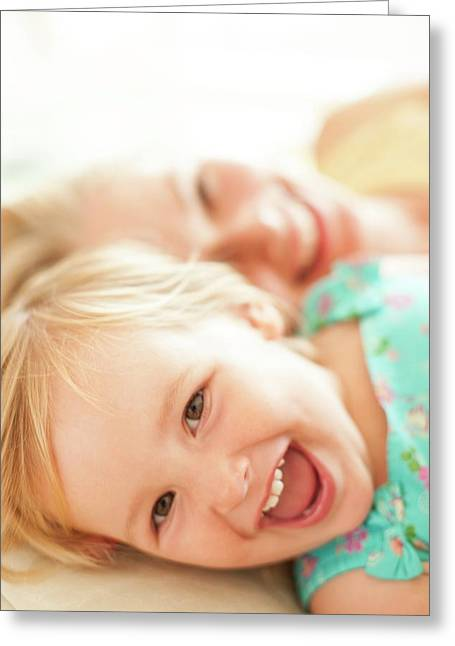 Young Girl Lying Down Laughing Greeting Card by Ian Hooton