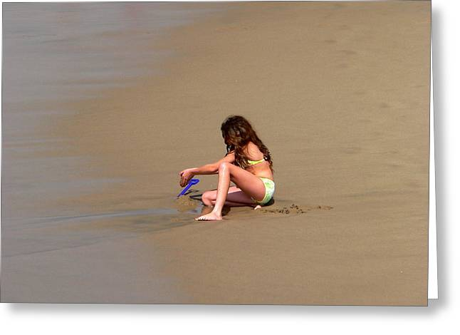 Young Girl Playing In Sand At Beach Greeting Card by Jeff Lowe
