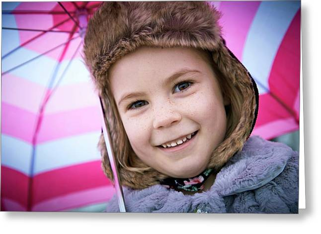 Young Girl Wearing Furry Hat With Umbrell Greeting Card by Ruth Jenkinson